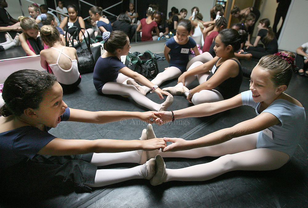 (091408  Boston, MA) Mikaila Wright, 10, left, and Kendra Abbott, 9, stretch before auditioning for Anthony William's Urban Nutcracker at BalletRox in jamaica Plain, Sunday,  September 14, 2008.  Staff photo by Angela Rowlings.