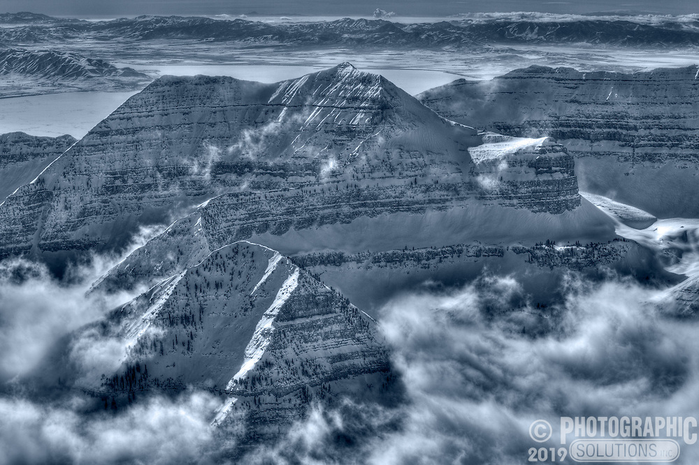 Clouds and snow covering the North side of Mount Timpanogos