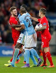 Fernandinho of Manchester City gets Adam Lallana of Liverpool by the throat as tensions rise in extra time with Yaya Toure of Manchester City - Mandatory byline: Rogan Thomson/JMP - 28/02/2016 - FOOTBALL - Wembley Stadium - London, England - Liverpool v Manchester City - Capital One Cup Final.