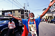 07 FEB 96 - PORT AU PRINCE, HAITI: A Haitian man cheers for newly installed Haitian president Rene Preval in front of the Haitian Legislative Palace Wednesday morning, Feb 7. For the first time in Haiti's history, one democratically elected president succeeded another Wednesday, when the tumultous term of President Jean Bertrand Aristide came to an end. .PHOTO BY JACK KURTZ
