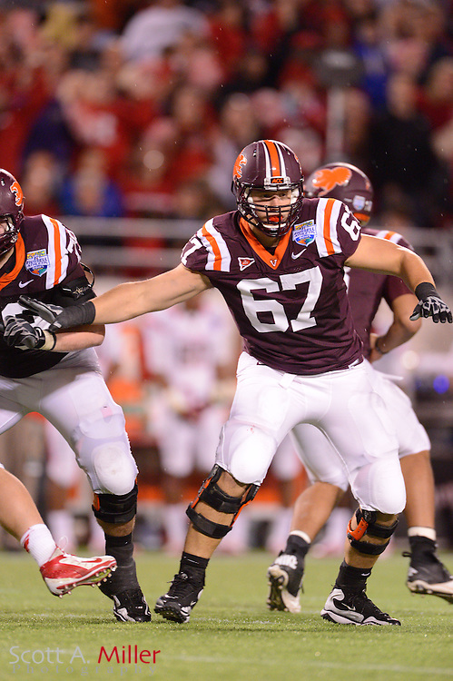 Virginia Tech Hokies offensive tackle Michael Via (67) during the Hokies 13-10 overtime win over the Rutgers Scarlet Knights in the Russell Athletic Bowl on Dec 28, 2012 in Orlando, Florida. ..©2012 Scott A. Miller..