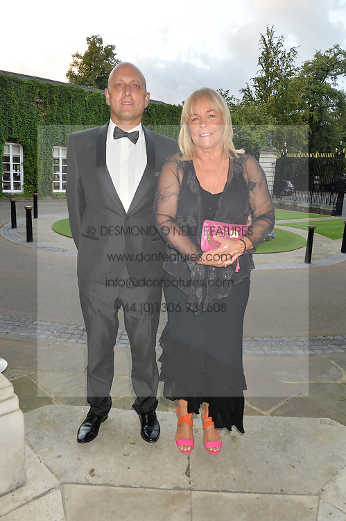 LINDA ROBSON and her husband MARK DUNFORD at 'A Night of Champions' an evening to raise funds for the Mo Farah Foundation held at The Hurlingham Club, London on 28th August 2014.