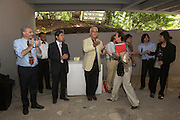 Giardini. Japanese Pavillion Grand Opening. Biennale President Paolo Baratta (White Jacket), being called to next event by his assistant.
