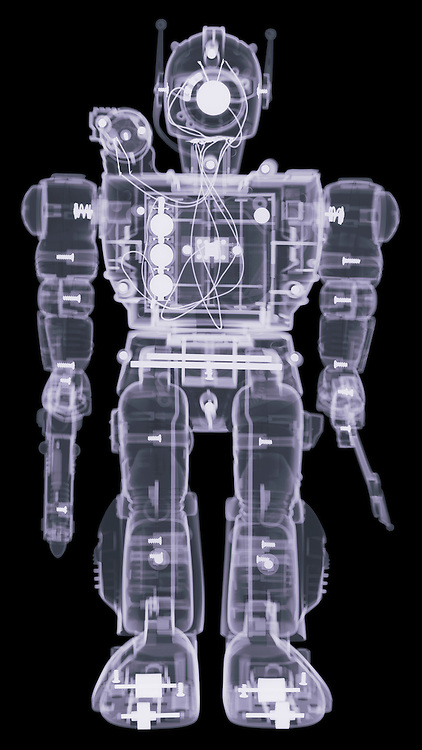 X-ray image of a toy warrior (color on black) by Jim Wehtje, specialist in x-ray art and design images.