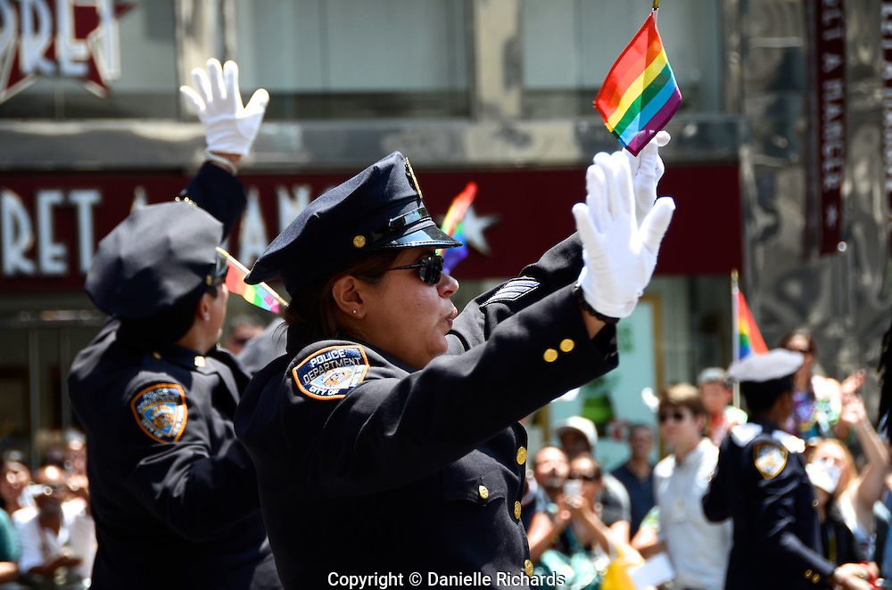 Members of NYPD Gay Officers Action League marching in the annual Pride Parade. Gay rights supporters had much to celebrate at this year's New York City Pride Parade, which came on the heels of the Supreme Court's decision to overturn DOMA (Defense of Marriage Act).  The ruling extends federal benefits to same-sex couples who are married in states that recognize gay marriage.