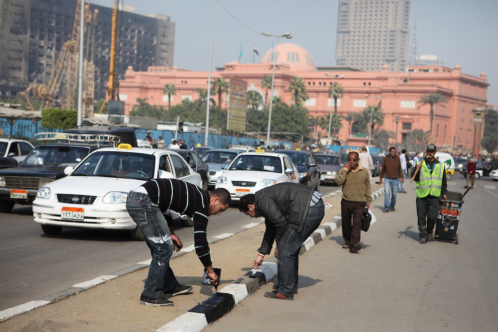 Volunteers help clean Tahrir Square three days after Mubarak was forced to step down as president.