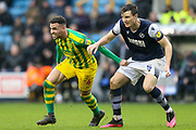 West Bromwich Albion forward Hal Robson-Kanu (4) battles for possession with Millwall defender Jake Cooper (5) during the EFL Sky Bet Championship match between Millwall and West Bromwich Albion at The Den, London, England on 9 February 2020.