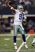 Dallas Cowboys quarterback Tony Romo (9) throws a first quarter pass during the NFL week 6 football game against the Washington Redskins on Sunday, Oct. 13, 2013 in Arlington, Texas. The Cowboys won the game 31-16. ©Paul Anthony Spinelli