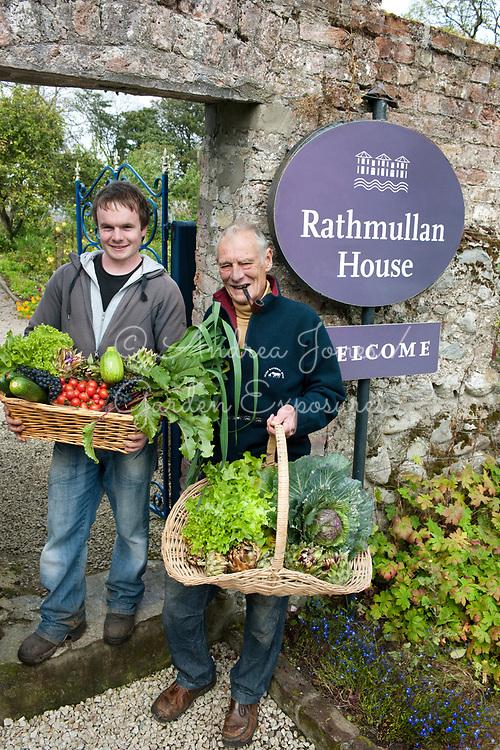 Mr Bob Wheeler with gardener holding produce from the Walled Garden<br /> <br /> Rathmullan House, Rathmullan, Co. Donegal, Ireland