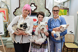 Left to right, AMBER BE BON and her dog Luigi, LULU GUINNESS and her dog Daphne and YASMIN LE BON and her dog Tinka at a party hosted by Lulu Guinness and Daphne's to launch Lulu's Designer Dog Bowl and to mark Daphne's allowing dogs through it's doors, held at Daphne's, Draycott Avenue, London on 28th June 2016.