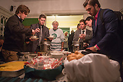 1960s hockey alumni as well as members of the current team get something to eat during the 1960s hockey reunion at the Konneker Alumni House on September 30, 2016.