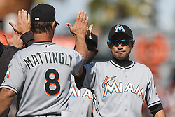 SAN FRANCISCO, CA - APRIL 24: Ichiro Suzuki #51 of the Miami Marlins celebrates with manager Don Mattingly #8 after the game against the San Francisco Giants at AT&T Park on April 24, 2016 in San Francisco, California.  The Miami Marlins defeated the San Francisco Giants 5-4. (Photo by Jason O. Watson/Getty Images) *** Local Caption *** Ichiro Suzuki; Don Mattingly