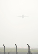 © Licensed to London News Pictures. 21/11/2011, Heathrow, UK.  A flight takes off in the fog. Flight delays continue at London's Heathrow Airport today. By 6.30am today a total of 21 flights from Heathrow were already cancelled affecting destinations including Manchester, Glasgow, Amsterdam, Brussels, Stockholm, Cologne and Nice.. Photo credit : Stephen Simpson/LNP