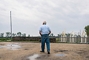 Farmer Ken Ries walks around his hog farm in Ryan, Iowa, U.S. May 18, 2019. Picture taken May 18, 2019.  REUTERS/Ben Brewer