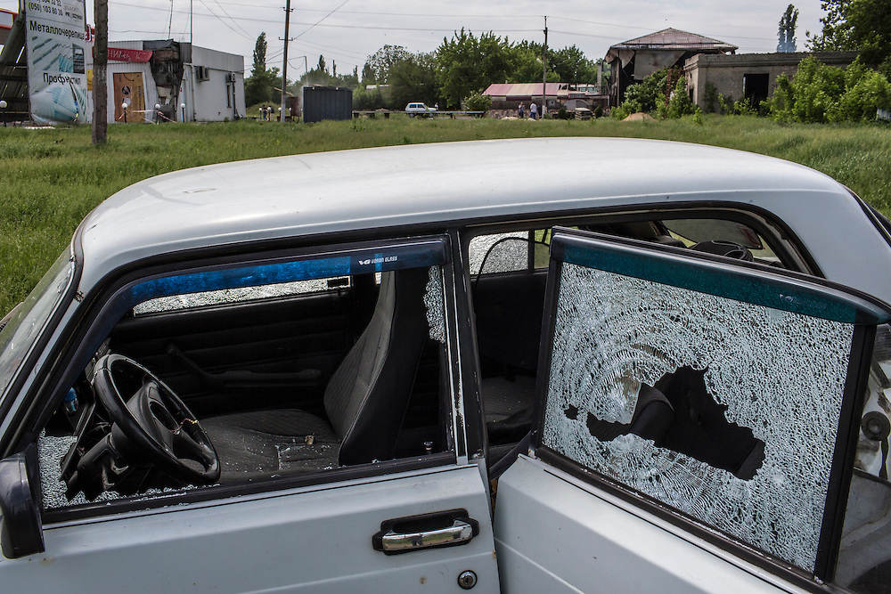 KARLIVKA, UKRAINE - MAY 23: A car is riddled with bullet holes at the scene of an early morning firefight between the pro-Ukraine Donbass Battalion and the pro-Russia Vostok Battalion militias on May 23, 2014 in Karlivka, Ukraine. At least eight people between the two sides, including one civilian, were killed in an early morning firefight when the Donbass Battalion, a pro-Ukraine militia, attacked a Vostok Battalion checkpoint in the nearby town of Karlivka. (Photo by Brendan Hoffman/Getty Images) *** Local Caption ***