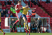 Marc Roberts (Barnsley) wins the header and clears the ball during the Sky Bet League 1 match between Barnsley and Scunthorpe United at Oakwell, Barnsley, England on 25 March 2016. Photo by Mark P Doherty.