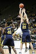 08 February 2007: Iowa center Stacy Schlapkohl (40) tires to shoot over Michigan forward Carly Benson (21) in Iowa's 66-49 win over Michigan at Carver-Hawkeye Arena in Iowa City, Iowa on February 8, 2007.