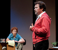 """Jim Rogato as Nick/Fireman recalls stories of his fellow firefighters who were lost on 9/11 while Katie Dunn as Joan/the Editor listens and takes notes during  dress rehearsal for """"The Guys"""" at the Winnipesaukee Playhouse on Wednesday evening.  (Karen Bobotas/for the Laconia Daily Sun)"""
