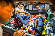 "30 NOVEMBER 2012 - BANGKOK, THAILAND:  Volunteer medics with the Ruamkatanyu Foundation put a man injured in a motorcycle accident into their ambulance to take him to a hospital during a Friday night shift. The Ruamkatanyu Foundation was started more than 60 years ago as a charitable organisation that collected the dead and transported them to the nearest facility. Crews sometimes found that the person they had been called to collect wasn't dead, and they were called upon to provide emergency medical care. That's how the foundation medical and rescue service was started. The foundation has 7,000 volunteers nationwide and along with the larger Poh Teck Tung Foundation, is one of the two largest rescue services in the country. The volunteer crews were once dubbed Bangkok's ""Body Snatchers"" but they do much more than that now.   PHOTO BY JACK KURTZ"