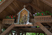 A Christian shrine in the roof of a rural village barn, on 18th June 2018, in Kupljenik, Slovenia
