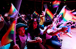 LGBT (lesbian, gay, bisexual and transgender) members of the audience wave rainbow coloured flags during the opening for the 10th National PFLAG conference on a cruise organised by Parents and Friends of Lesbians and Gays (PFLAG) on open seas on route to Sasebo, Japan, 15 June 2017. About 800 members of the Chinese LGBT (lesbian, gay, bisexual and transgender) community and their parents spent four days on a cruise trip organised by Parents and Friends of Lesbians and Gays (PFLAG) China, a grassroots non-government organisation, celebrating the 10th anniversary of the organisation. It aims to promote coexistence among homosexuals and their families.