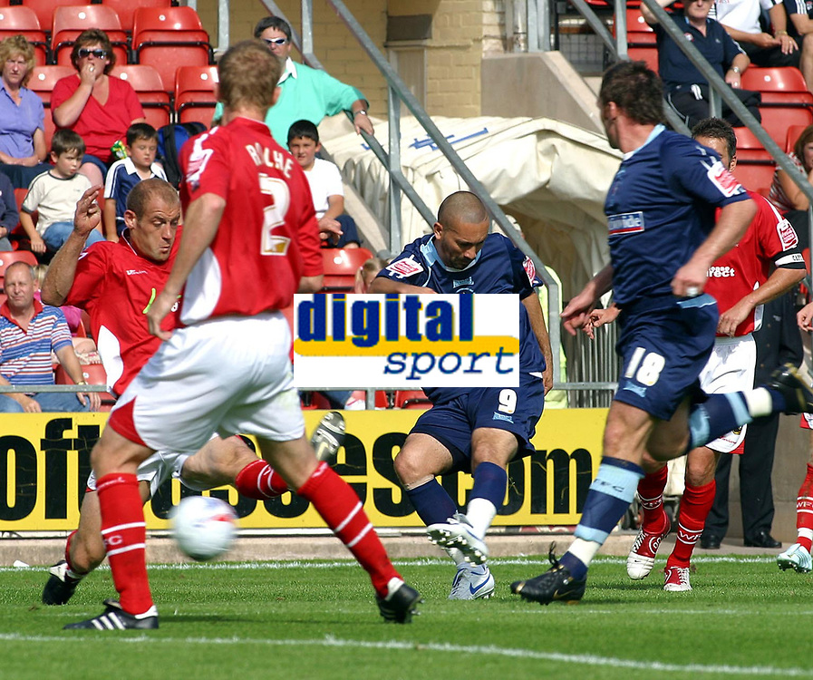 Photo: Dave Linney.<br />Wrexham v Swindon Town. Coca Cola League 2. 09/09/2006Swindon's .Christian Roberts (9) manages to get a shot on goal.