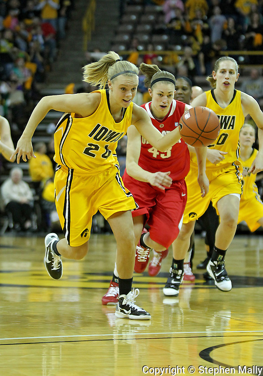 January 08 2010: Iowa guard Jaime Printy (24) drives down court during the first half of an NCAA womens college basketball game at Carver-Hawkeye Arena in Iowa City, Iowa on January 08, 2010. Iowa defeated Ohio State 89-76.