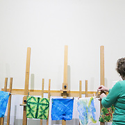 "Nancy Hawfield hangs a quilt square to dry during ""Create Your Own Quilt Squares"" Sunday November 23, 2014 at the Cameron Art Museum in Wilmington, N.C. (Jason A. Frizzelle)"