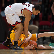 31 January 2017:  The San Diego State Aztecs men's basketball team hosts Wyoming Tuesday night at Viejas Arena. San Diego State guard Trey Kell (3) battles for a loose ball with Wyoming forward Hayden Dalton (20) in the second half. The Aztecs beat the Cowboys 77-68 at half time. www.sdsuaztecphotos.com