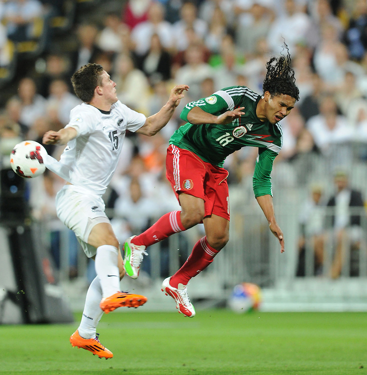 New Zealand's Louis Fenton, left, and Mexico's Carlos Pena clash in the World Cup Football qualifier, Westpac Stadium, Wellington, New Zealand, Wednesday, November 20, 2013. Credit:SNPA / Ross Setford