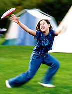 Girl playing frisbee during the annual campout at the Forest Park Park District..