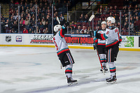 KELOWNA, BC - DECEMBER 30: Trevor Wong #8 and Ethan Ernst #19 skate to Kaedan Korczak #6 of the Kelowna Rockets to celebrate a first period goal against the Prince George Cougars at Prospera Place on December 30, 2019 in Kelowna, Canada. (Photo by Marissa Baecker/Shoot the Breeze)