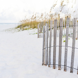 Pensacola Beach Florida beach fence and beach grass photo. Pensacola Beach is a coastal city in the Emerald Coast area of the Southeastern United States. Copyright ⓒ 2018 Paul Velgos with All Rights Reserved.