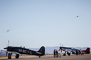 RENO, NV - SEPTEMBER 13: Jets pass by vintage airplanes waiting to fly at the Reno Championship Air Races on September 13, 2017 in Reno, Nevada. (Photo by Jonathan Devich/Getty Images)