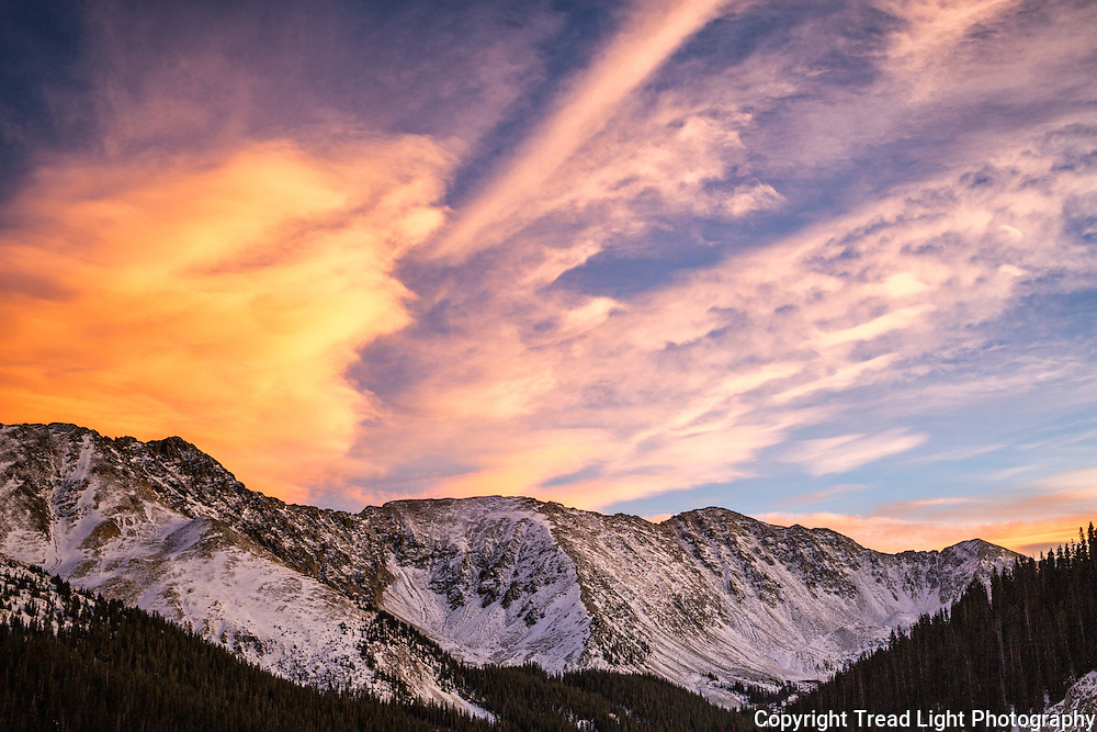 Eastern clouds and the western slopes of Loveland pass catch the golden hour in all its majesty.