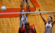 1 Nov. 2011 -- EDWARDSVILLE, Ill. -- Belleville West High School girls' volleyball players Emily Becker (19) and Taylor Puuri (11) deflect a spike attempt by Edwardville High School's Hannah Frierdich (12) during the IHSA Class 4A girls volleyball sectional semifinal at Edwardsville High School in Edwardsville, Ill. Tuesday, Nov. 1, 2011. Edwardsville won, 2-1. Photo © copyright 2011 Sid Hastings.