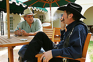 Jay Johnson Castro meets with Gubernatorial candidate Kinky Friedman at Laredo's La Posada hotel before a press conference about his walk on Monday, October 9, 2006. Castro said he was walking over 200 miles from Laredo to Brownsville to protest the proposed border wall along the Rio Grande.