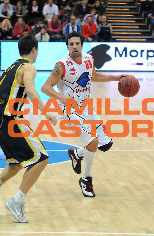 DESCRIZIONE : Piacenza Campionato Lega Basket A2 2011-12 Morpho Basket Piacenza Givova Scafati<br /> GIOCATORE : German Scarone<br /> SQUADRA : Morpho Basket Piacenza<br /> EVENTO : Campionato Lega Basket A2 2011-2012<br /> GARA : Morpho Basket Piacenza Givova Scafati<br /> DATA : 30/10/2011<br /> CATEGORIA : Palleggio<br /> SPORT : Pallacanestro <br /> AUTORE : Agenzia Ciamillo-Castoria/L.Lussoso<br /> Galleria : Lega Basket A2 2011-2012 <br /> Fotonotizia : Piacenza Campionato Lega Basket A2 2011-12 Morpho Basket Piacenza Givova Scafati<br /> Predefinita :