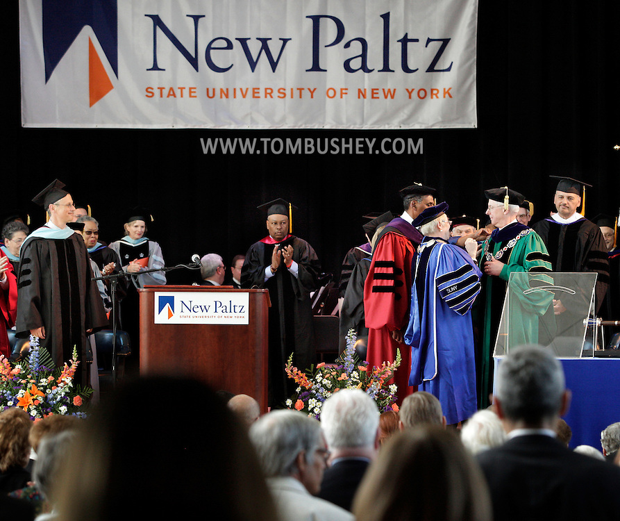 New SUNY New Paltz president Donald P. Christian, second from right, gets his presidential chain and a standing ovation during his installation ceremony at Julien J. Studley Theatre on the New Paltz campus on Friday, April 13, 2012.