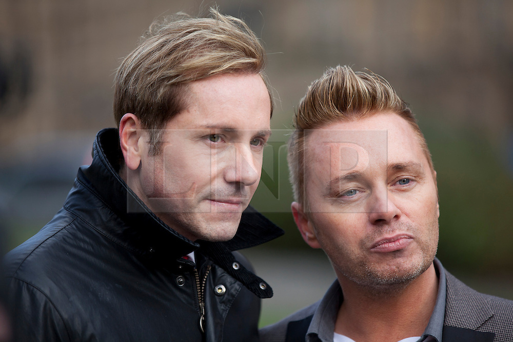 © Licensed to London News Pictures. 05/02/2013. London, UK. As parliament debates same sex marriage Barrie and Tony Drewitt-Barlow, Britain's first gay surrogate parents are seen outside Parliament in London today (05/02/13). Photo credit: Matt Cetti-Roberts/LNP