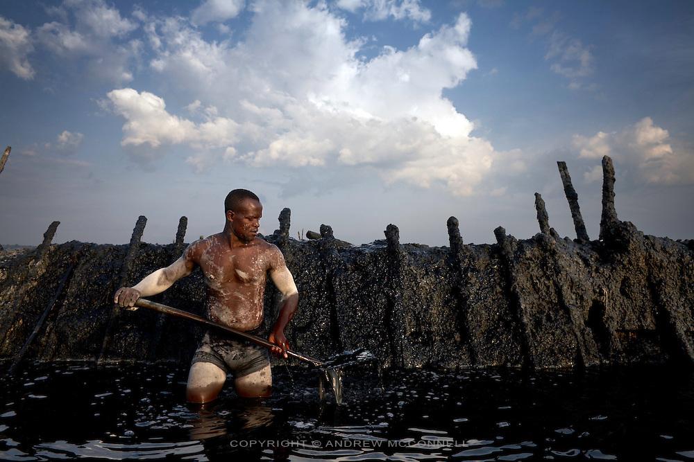 A man removes mud from a salt pan at Lake Katwe, Uganda.