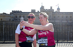 Runners take a selfie outside the Tower of London during the 2019 London Landmarks Half Marathon.