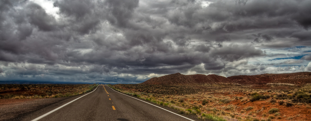 Storm clouds rolling in on highway Alt 89 towards the north rim of the Grand Canyon National Park.