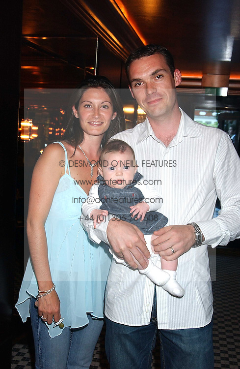 MIKAEL &amp; ANNABEL ALLAN, sister of Mati White, with their daughter ANIELA  at the opening party of the new Frankie's Italian Bar and Grill hosted by Frankie Dettori, Marco Pierre White and Edward Taylor at 68 Chiswick High Road, London W4 on 1st September 2005.<br />