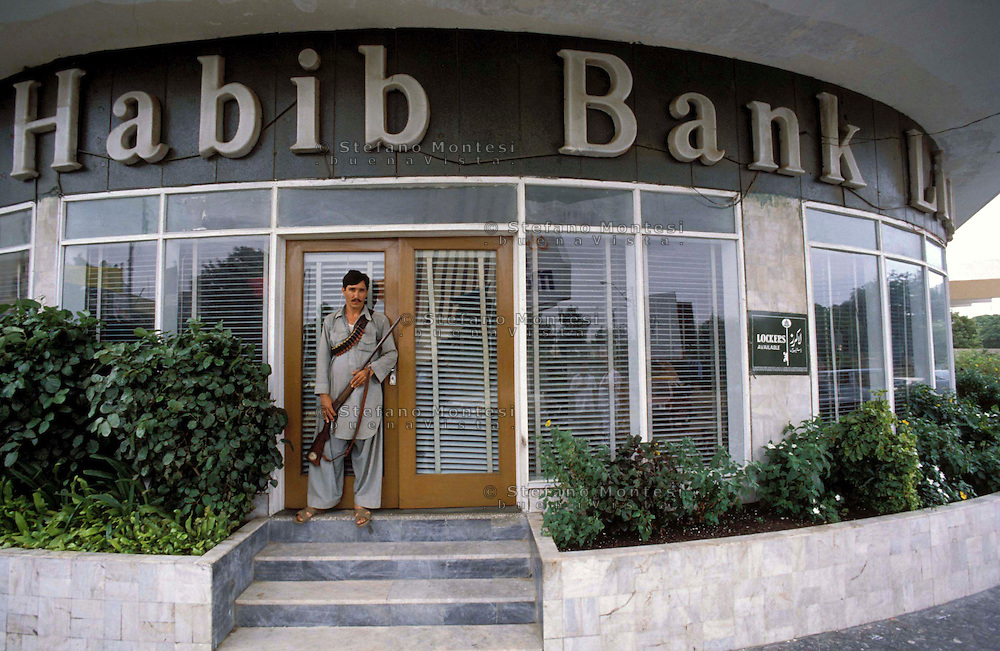 Pakistan  Karachi 1986..Private security guards stand at the main entrance of a bank building