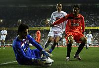 Photo: Paul Thomas.<br /> Tottenham Hotspur v Sevilla. UEFA Cup. Quarter Final, 2nd Leg. 12/04/2007.<br /> <br /> Dimitar Berbatov (White) of Spurs can't get past Julien Escude (R) before Sevilla keeper David Cobeno jumps on the ball.