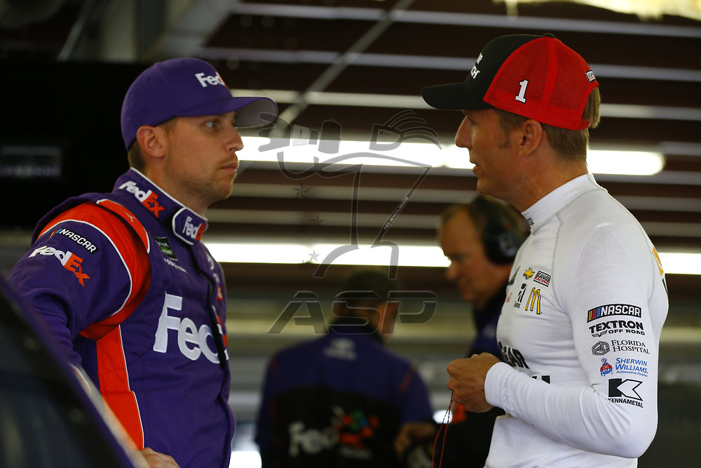 July 14, 2017 - Loudon, NH, USA: Jamie McMurray (1) and Denny Hamlin (11) hang out in the garage during practice for the Overton's 301 at New Hampshire Motor Speedway in Loudon, NH.