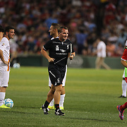 Liverpool manager Brendan Rodgers heads to the bench for the second half during the Liverpool Vs AS Roma friendly pre season football match at Fenway Park, Boston. USA. 23rd July 2014. Photo Tim Clayton