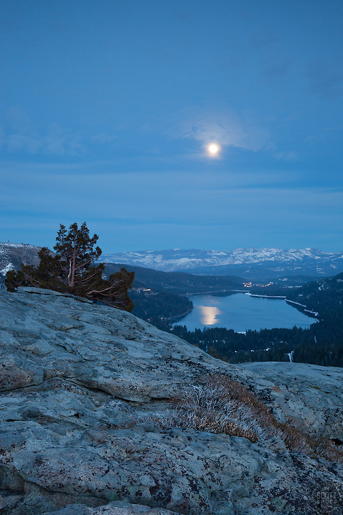 """Donner Lake Evening"" - Photograph of a boulder, tree, and a moon above Donner Lake and Truckee, California."