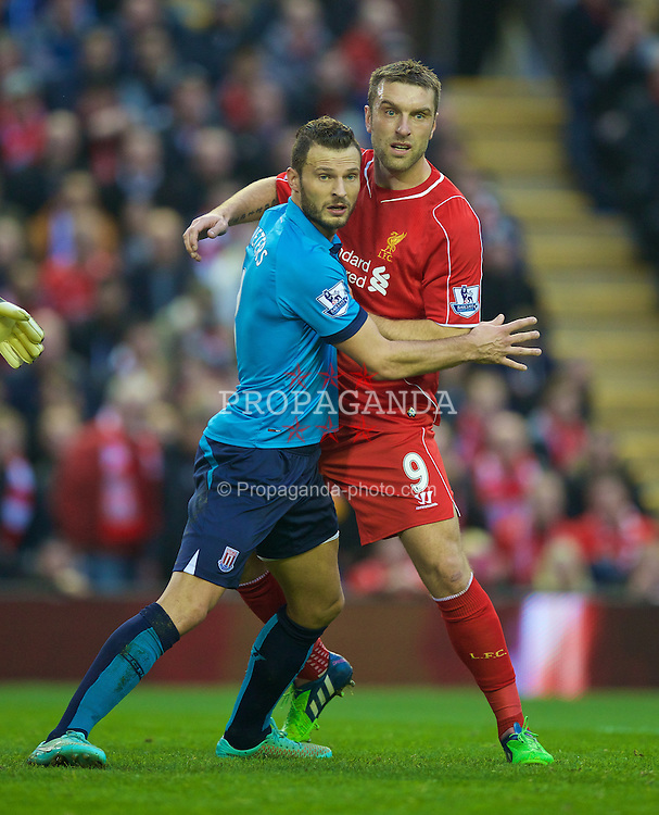 LIVERPOOL, ENGLAND - Saturday, November 29, 2014: Liverpool's Rickie Lambert in action against Stoke City's Marc Wilson during the Premier League match at Anfield. (Pic by David Rawcliffe/Propaganda)